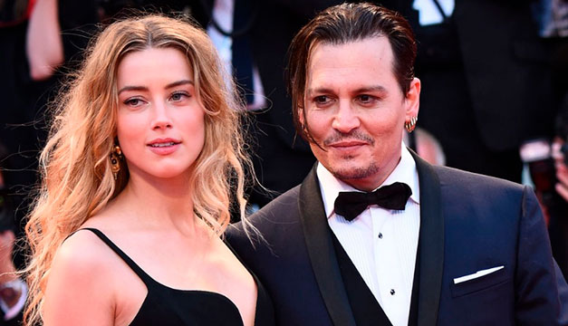 Amber Heard reacciona molesta ante petición de fanáticos